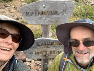 Couple at sign at top of Abineau trail