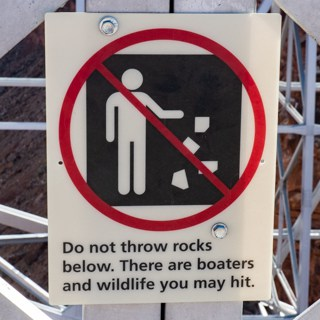 Do not throw rocks sign on Navajo Bridge on your RV adventure!