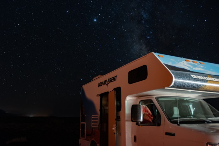 Camper under night sky