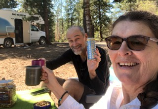 Karin and Franz enjoying a beer in the woods